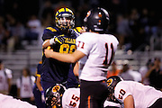Milpitas High School defensive lineman Jason Scrempos (88) points and yells at Woodside quarterback Robert Wang (11) at Milpitas High School in Milpitas, California, on September 13, 2013. The Trojans went on to beat the Wildcats 50-6. (Stan Olszewski/SOSKIphoto)