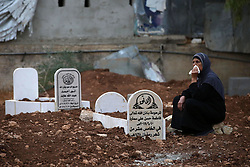 September 1, 2017 - Nablus, West Bank, Palestinian Territory - A Palestinian woman visits the grave of her relative at a cemetery on the first day of Eid al-Adha, or feast of the sacrifice, in the West Bank village of Lubban Ash-Sharqiya near Nablus, on September 1, 2017. Muslims around the world are celebrating Eid al-Adha, the ''Feast of Sacrifice'', which marks the end of the annual pilgrimage or hajj to the Saudi holy city of Mecca and in remembrance of Abraham's readiness to sacrifice his son to God  (Credit Image: © Ayman Ameen/APA Images via ZUMA Wire)
