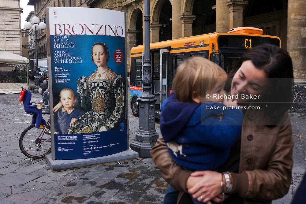 Modern Italian mother and child and Agnolo de Cosimo Bronzino's painting of the Medici Eleanora of Toledo and son Giovanni C1545...Eleonora di Toledo (1522 - 1562), the daughter of Don Pedro Álvarez de Toledo, the Spanish viceroy of Naples. Her face is still familiar to many because of her solemn and distant portraits by Agnolo Bronzino. She provided the Medici with the Pitti Palace  and seven sons to ensure male succession and four daughters to connect the Medici with noble and ruling houses in Italy. She was a patron of the new Jesuit order, and her private chapel in the Palazzo Vecchio  was decorated by Bronzino, who had originally arrived in Florence to provide festive decor for her wedding. She died, with her sons Giovanni and Garzia, in 1562, when she was only forty; all three of them were struck down by malaria while traveling to Pisa.
