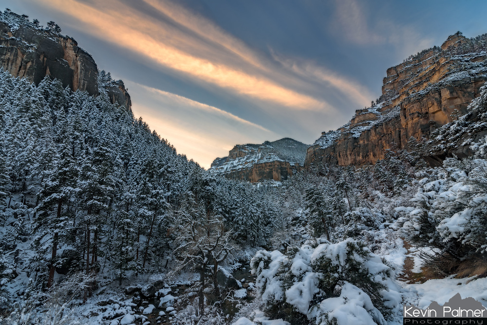 """This was the first major snowfall of the season in northern Wyoming. Up to 12"""" fell in the valleys, with more in the higher elevations. I went to take pictures at one of my favorite places to hike, Tongue River Canyon. This deep canyon ascends into the northern Big Horn Mountains west of Dayton. The canyon looked stunning with snow clinging to the sheer cliffs and trees, and the river gurgling below. Above the walls are found interesting geological features likes arches, spires, and caves, one of which has over a mile of passages. I wasn't sure if I would be able to make it up the narrow gravel road which was unplowed, but it wasn't a problem with 4WD. Last time I was here I spotted a black bear running up the road, but I'm sure most of them are in hibernation by now."""