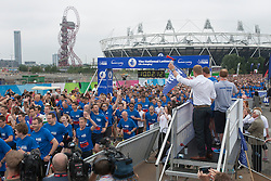 © licensed to London News Pictures. London, UK 21/07/2013. Sir Chris Hoy starting The National Lottery Anniversary Run at Queen Elizabeth Olympic Park on Sunday, 21 July 2013 to support 12,500 runners. The Stadium at Queen Elizabeth Olympic Park open its doors to the public for the first time since London 2012. Photo credit: Tolga Akmen/LNP