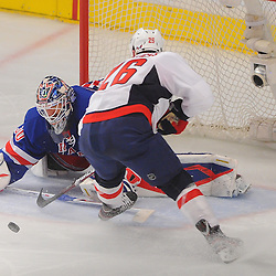 April 30, 2012: New York Rangers goalie Henrik Lundqvist (30) poke checks the puck away from Washington Capitals left wing Matt Hendricks (26) during second period action in Game 2 of the NHL Eastern Conference Semifinals between the Washington Capitals and New York Rangers at Madison Square Garden in New York, N.Y.