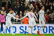 Harry Winks (England) congratulates Jesse Lingard (England) following the goal from Trent Alexandra-Arnold (England) during the international Friendly match between England and USA at Wembley Stadium, London, England on 15 November 2018.