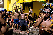 "Men and women drinking and dancing during the celebrations of the  ""Boi Bumba"" Amazon Carnival, Parintins, Brazil. The carnival serves to celebrate and re-enact Indian traditions and perpetuate myths and legends. It has evolved over time and involves the battle between to opposing bulls, known as Garantido and Caprichoso."