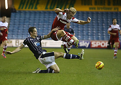 Middlesbrough's Curtis Main takes-evasive action from Millwall's Paul Robinson - Photo mandatory by-line: Robin White/JMP - Tel: Mobile: 07966 386802 21/12/2013 - SPORT - FOOTBALL - The Den - Millwall - Millwall v Middlesbrough - Sky Bet Championship