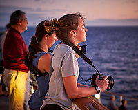 Sunrise Photography Club waiting for the sun to rise. Aft deck of the MV World Odyssey. Image taken with a Fuji X-T1 camera and 35 mm f/1.4 lens (ISO 1600, 35 mm, f/2, 1/60 sec). Raw image processed with Capture One Pro, noise reduction with NIK Define 2.