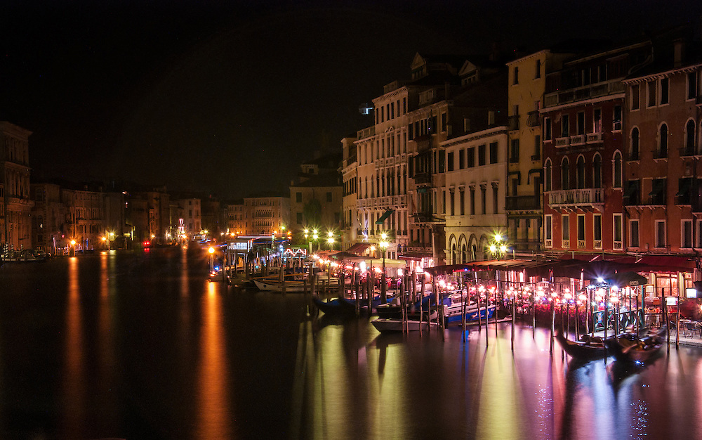 The view from the Rialto bridge at night.