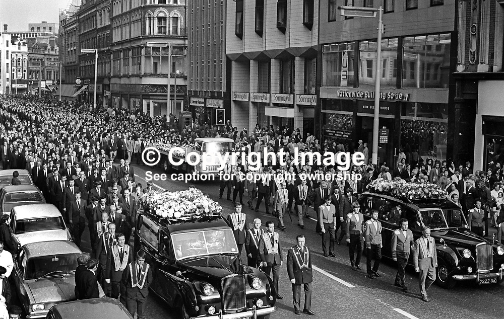 Funeral of Alexander Andrews and Ernest Bates passes along Royal Avenue, Belfast, N Ireland, UK. They died in a no warning Provisional IRA bomb attack on the Four Step Inn on the Loyalist Shankill Road on 29th September 1971.  Andrews was helping out in the bar; Bates was a customer.  A local newspaper estimated that 50,000 joined the cortege. It was reckoned to be one of the biggest funerals during the Troubles. 197110020376<br /> <br /> Copyright Image from Victor Patterson, Belfast, UK<br /> <br /> t: +44 28 9066 1296 (from Rep of Ireland 048 9066 1296)<br /> m: +44 7802 353836<br /> e: victorpattersonbelfast@gmail.com<br /> <br /> www.images4media.com<br /> <br /> Please see my full Terms and Conditions of Use at https://www.images4media.com/p/terms-conditions - it is IMPORTANT that you familiarise yourself with them.<br /> <br /> Images used online incur an additional cost. This cost should be agreed in writing in advance. Online images must be visibly watermarked i.e. © Victor Patterson or that of the named photographer within the body of the image. The original metadata must not be deleted from images used online.<br /> <br /> This image is only available for the use of the download recipient i.e. television station, newspaper, magazine, book publisher, etc, and must not be passed on to a third party. It is also downloaded on condition that each and every usage is notified within 7 days to victorpattersonbelfast@gmail.com.<br /> <br /> The right of Victor Patterson (or the named photographer) to be identified as the author is asserted in accordance with The Copyright Designs And Patents Act (1988). All moral rights are asserted.