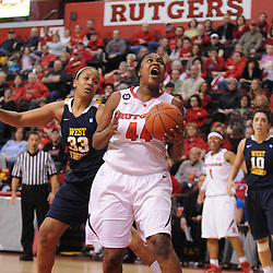 Rutgers Scarlet Knights forward/center Monique Oliver (44) puts up a basket in the paint past defender West Virginia Mountaineers center Ayana Dunning (33) during first half Big East NCAA women's basketball action between Rutgers and West Virginia at the Louis Brown Rutgers Athletic Center