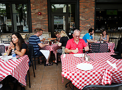 October 7, 2016 - Florida, U.S. - People dine out  at Grimaldi's Pizzeria in Downtown at the Gardens, Friday  afternoon after the passing of Hurricane Matthew, October 7, 2016 in Palm Beach Gardens. (Credit Image: © Yuting Jiang/The Palm Beach Post via ZUMA Wire)