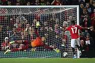 Manchester United's Fred scores past Rochdale's Robert Sanchez during the penalty shoot out at the EFL Cup match between Manchester United and Rochdale at Old Trafford, Manchester, England on 25 September 2019.