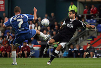 Photo: Paul Thomas.<br /> Oldham Athletic v Swindon Town. Coca Cola League 1.<br /> 10/12/2005.<br /> <br /> Tom Wiilliams (R) of Swansea shoots at goal and is almost stopped by Richie Wellens.