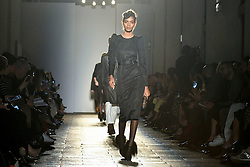 Models on the catwalk during the Bottega Veneta catwalk show held during Milan Fashion Week in Italy