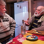 "Alexander Demidov, 61, sits with his friend, writer Stanislav Konstatinov 65, Chernobyl explosion in 1986. They were part of  a massive team of ""liquidators"" responsible for the clean up of the nuclear fallout in the months and years that followed. <br /> <br /> They have been living in Slavutych for the last decades. Demidov is suffering from multiple health problems in his lungs and joints, while Konstantinov is healthy. <br /> <br /> Slavutych rises out of the ashes of the Chernobyl nuclear disaster in April 26, 1986. People living near the disaster area were largely moved to the new city, built from scratch for the sole purpose of housing the population displaced by the nuclear accident."
