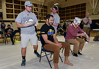 "Leaman Antone braces for what's coming after watching Jason Javalgi get ""pied"" by Tyler Pearson at Gilford High School during the ""Pie a Teacher"" to benefit The Doorway at LRGH on Friday afternoon.  (Karen Bobotas/for the Laconia Daily Sun)"