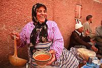 woman serving soup in Marrakech..Photograph by Owen Franken ..