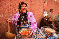 woman serving soup in Marrakech..Photograph by Owen Franken ..