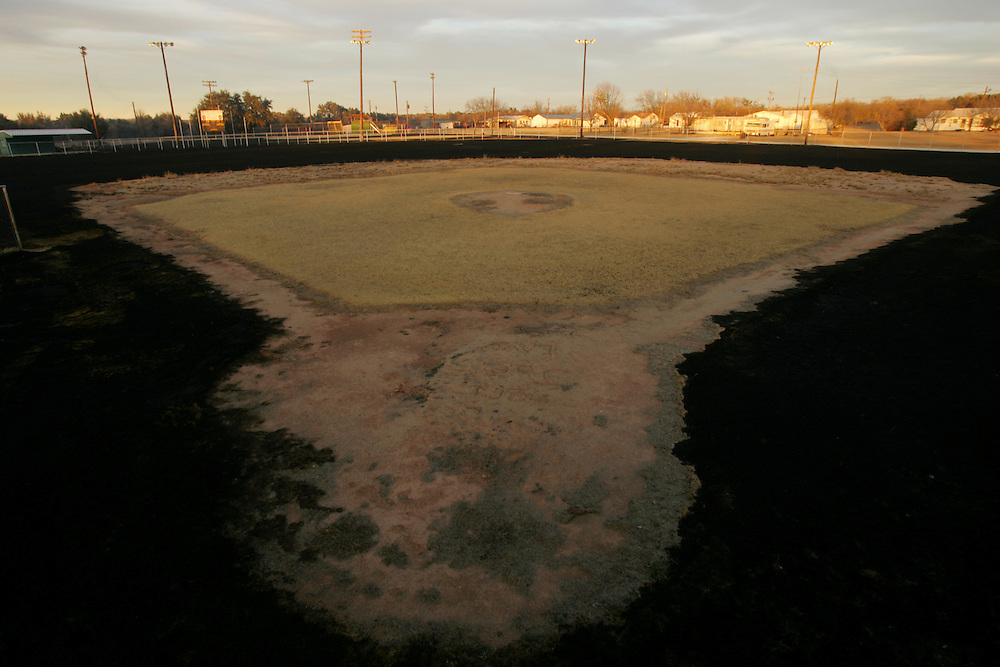 © 2005 Alex Jones www.alexjonesphoto.com..A baseball diamond sits partially burned on Wednesday, December 28, 2005 in Cross Plains, Texas.  The town was heavily damaged by an uncontrolled grass fire on Tuesday, one of many in the state.