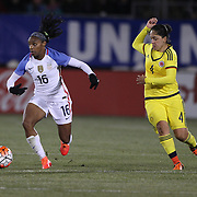 Crystal Dunn, (left), USA, dribble past Diana Ospina, Colombia, during the USA Vs Colombia, Women's International friendly football match at the Pratt & Whitney Stadium, East Hartford, Connecticut, USA. 6th April 2016. Photo Tim Clayton