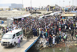 Bangladeshi garments workers wait to get on board of a over crowed ferry as they returning to their village homes at the Shimulia ferry terminal in Mawa, near Dhaka, Bangladesh, April 05, 2020. Thousands of readymade garment workers from across the country had either walked or used alternative modes of transpiration to reach capital Dhaka over the past few days, as owners decided to open the factories amid a government-enforced soft shutdown to prevent the novel coronavirus from spreading further. But following harsh criticisms, BGMEA was forced to keep the factories closed until April 11. The workers were told to go back home when they went to the factories to join work on Sunday morning. Photo by Suvra Kanti Das/ABACAPRESS.COM
