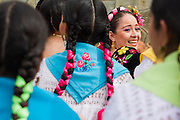 Performers sit and laugh in the bleachers at the Guelaguetza Auditorium on Cerro del Fortin in Oaxaca City, Oaxaca state, Mexico on July 21, 2008. The Guelaguetza is an annual folk dance festival - dancers from all corners of the state gather in celebration in Oaxaca City and towns in the Central Valley to perform their traditional dances.
