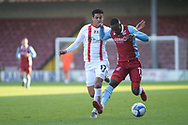 Scunthorpe United Abo Eisa (11) Leyton Orient Louis Dennis (17) battles for possession during the EFL Sky Bet League 2 match between Scunthorpe United and Leyton Orient at the Sands Venue Stadium, Scunthorpe, England on 5 December 2020.
