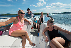 Boat ride from the Naswa to the Weir's during Laconia Motorcycle Week. Laconia, NH, USA. June 13, 2015.  Photography ©2015 Michael Lichter.