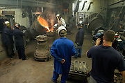 UK - Friday, Aug 01 2008:  With a film crew recording the process, workers at the Whitechapel Bell Foundry in London pour molten metal into the cast of the 5th bell. (Photo by Peter Horrell / http://www.peterhorrell.com)