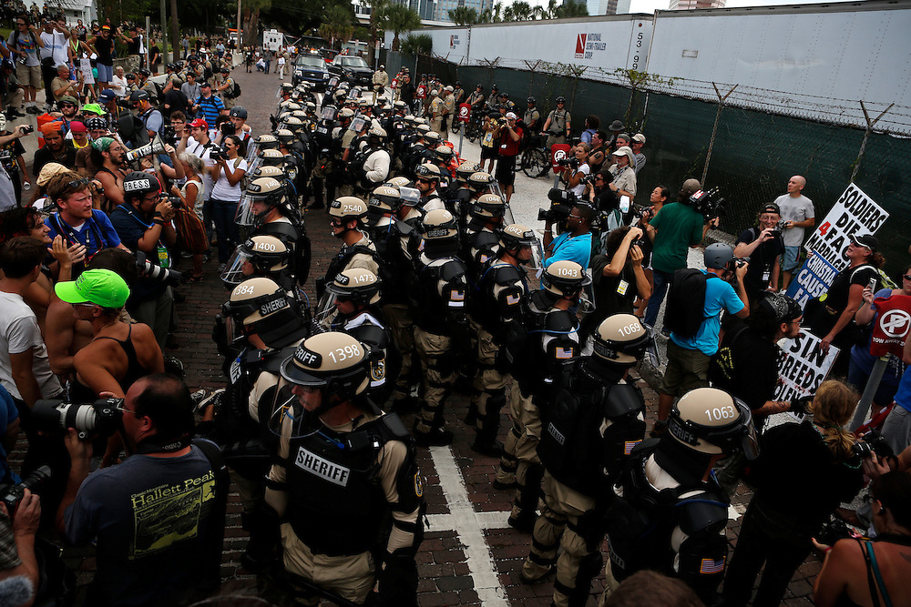 Florida law enforcement officers stand between protesters and members of the Westboro Bapist Church during the 2012 Republican National Convention on August 28, 2012 in Tampa, Fla. Westboro Baptisit Church members are known for their inflammatory views.
