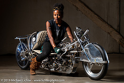 Jalika Gaskin with a custom 1950 Ironhead Triumph with all handmade bodywork built by Alp Sungurtekin, which was the first vintage bike to reach 200mph. Originally rated at 33 bh in 1953, this bike running on 98% nitro methane is rated at 175+ hp. At the Handbuilt Show. Austin, TX. USA. Thursday April 19, 2018. Photography ©2018 Michael Lichter.