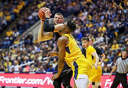 Mar 20, 2019; Morgantown, WV, USA; Grand Canyon Antelopes forward Michael Finke (43) makes contact with West Virginia Mountaineers forward Derek Culver (1) during the second half at WVU Coliseum. Mandatory Credit: Ben Queen