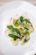 Local caught sashimi with green chili sauce, fresh herbs and fried shallots
