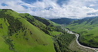 Aerial view of the green and lush landscape valley, Ingushetia, Russia