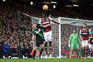 Cheikhou Kouyate of West Ham United heads the ball over Jonathan Walters of Stoke City. Barclays Premier league match, West Ham Utd v Stoke city at the Boleyn Ground, Upton Park  in London on Saturday 12th December 2015.<br /> pic by John Patrick Fletcher, Andrew Orchard sports photography.