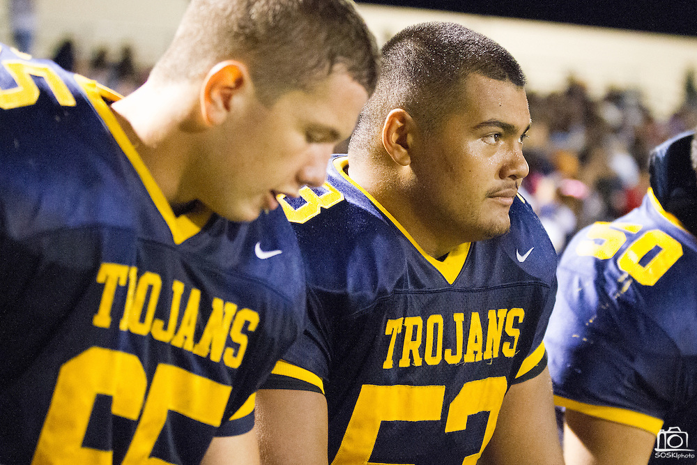 Milpitas High School sophomore, Jason Scrempos (65), and senior, Zoell Lei (53) (right), talk on the sideline during the fourth quarter of the Oct. 5, 2012, home game against Mountain View.  The Trojans would go on to win 42-7.  Photo by Stan Olszewski/SOSKIphoto.