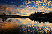 Clouds reflected in Middle Lake at sunset<br /> Kenora<br /> Ontario<br /> Canada