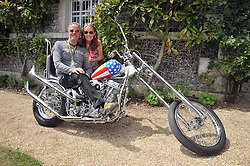 Margaret DeVogelaere and PETER FONDA  at a luncheon hosted by Cartier for their sponsorship of the Style et Luxe part of the Goodwood Festival of Speed at Goodwood House, West Sussex on 5th July 2009.