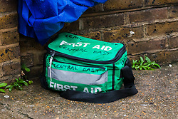 © Licensed to London News Pictures. 13/10/2019. London, UK. Plastic. Sheeting and a first aid medical box within the police crime scene cordon in Turner Street at the back of the Royal London Hospital in Whitechapel, east London. Police were called at 2:05pm yesterday, 12th October to reports of men fighting in Turner Street and a man with multiple stab wounds was taken to hospital where his condition was described as critical. Two men were arrested at the scene by police on suspicion of attempted murder. Photo credit: Vickie Flores/LNP