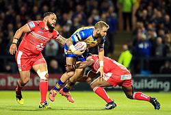 Leeds Rhinos' Adam Cuthbertson breaks through the Salford line during the Betfred Super8's match at Headingley Carnegie, Leeds.