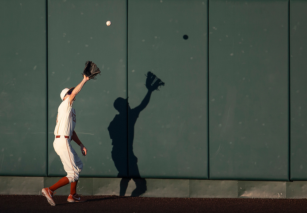 Texas outfielder Duke Ellis (11) catches a fly ball during an NCAA baseball game against Rice on Tuesday, April 9, 2019, in Austin, Texas. [NICK WAGNER/AMERICAN-STATESMAN]