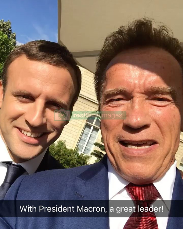 """Arnold Schwarzenegger releases a photo on Instagram with the following caption: """"I was truly honored to meet with President @emmanuelmacron about how we can work together for a clean energy future. He's a great leader."""". Photo Credit: Instagram *** No USA Distribution *** For Editorial Use Only *** Not to be Published in Books or Photo Books ***  Please note: Fees charged by the agency are for the agency's services only, and do not, nor are they intended to, convey to the user any ownership of Copyright or License in the material. The agency does not claim any ownership including but not limited to Copyright or License in the attached material. By publishing this material you expressly agree to indemnify and to hold the agency and its directors, shareholders and employees harmless from any loss, claims, damages, demands, expenses (including legal fees), or any causes of action or allegation against the agency arising out of or connected in any way with publication of the material."""
