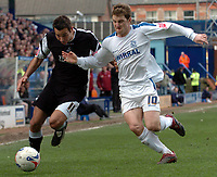 Photo: Paul Greenwood.<br />Tranmere Rovers v Swansea City. Coca Cola League 1. 10/03/2007.<br />Swansea's Pawel Abbott (L) and Chris Greenacre battle for the ball