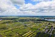 Nederland, Noord-Holland, Gemeente Oostzaan, 14-06-2012; Polder Oostzaan, gezien naar het lintdorp Oostzaan. Rechts achter het dorp de Stootersplas in recreatiegebied Het Twiske. Autosnelweg A9 (ring Zaandam) in de voorgrond. .De verkaveling in het gebied is het resultaat van veenontginning. .Polder and village Oostzaan, north of Amsterdam. The division in plots in the area is the result of peat extraction..luchtfoto (toeslag), aerial photo (additional fee required);.copyright foto/photo Siebe Swart