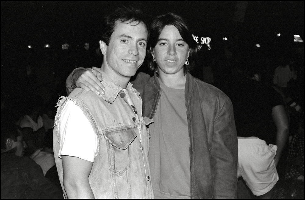 Peter Cramer and Sarah Schulman at Wigstock, an annual outdoor drag festival that began in the 1980s in Tompkins Square Park in the East Village of New York City that took place on Labor Day in 1989.