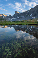Pronghorn Peak reflected in pond near Lee Lake, Bridger Wilderness. Wind River Range, Wyoming
