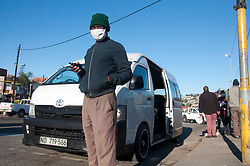 A taxi rank marshal wearing a face mask during the COVID-19 crisis in Durban, South Africa.