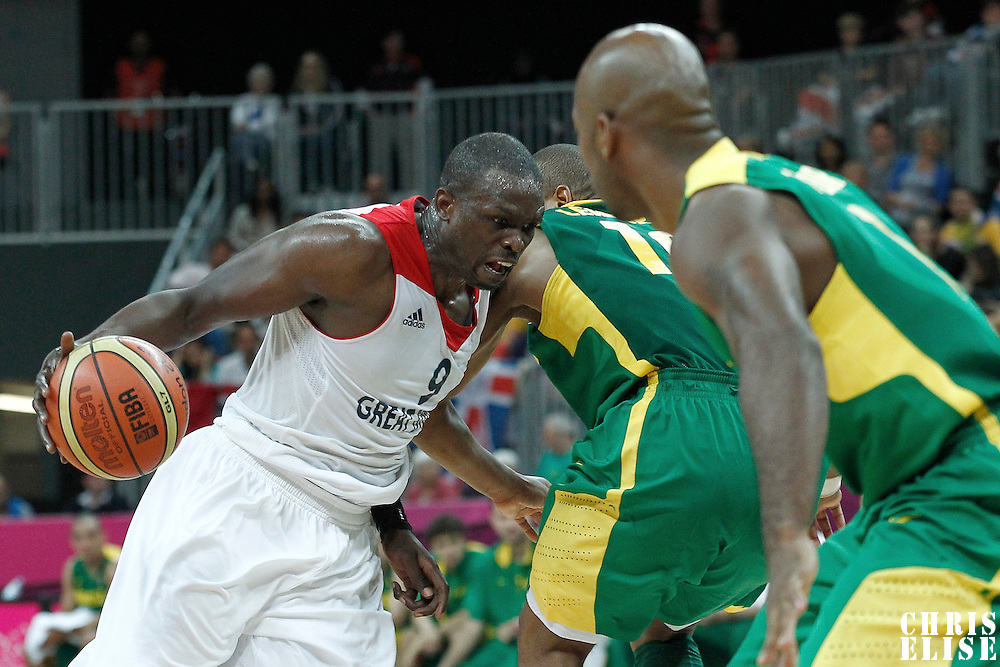 31 July 2012: Great Britain Luol Deng drives past Brazil Leandrinho Barbosa during 67-62 Team Brazil victory over Team Great Britain, during the men's basketball preliminary, at the Basketball Arena, in London, Great Britain.