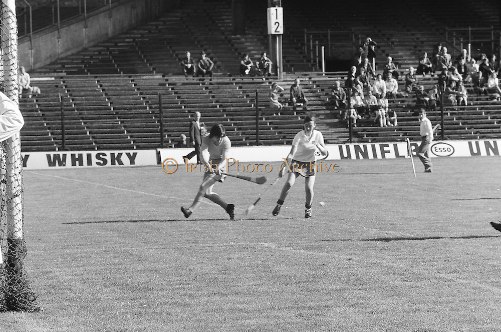 Wexford waiting on the slitor to come towards her as Cork tries to block it during the All Ireland Senior Camogie Final Cork v Wexford in Croke Park on the 21st September 1975.