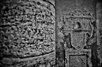 Black and white photo, aged stone work and etching, Pienza, Italy.