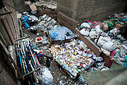 In the backyards of the blocks stored the collected material. Everything is too close, laundry and garbage.